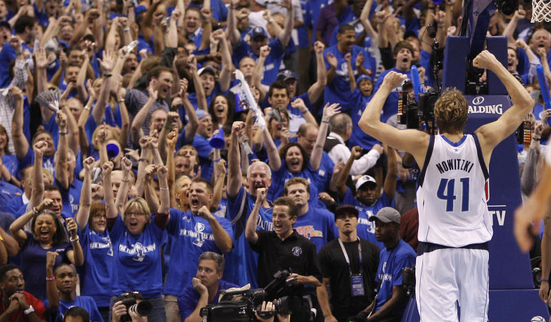 Dallas Mavericks forward Dirk Nowitzki (41) of Germany holds up his arms as fans cheer during the final seconds of Game 5 of the NBA basketball Western Conference finals against the Oklahoma City Thunder Wednesday, May 25, 2011, in Dallas.  The Mavericks won 100-96. (AP Photo/Eric Gay)