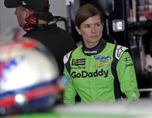 "<a class=""link rapid-noclick-resp"" href=""/nascar/nationwide/drivers/1311"" data-ylk=""slk:Danica Patrick"">Danica Patrick</a> looks over her car before a NASCAR auto racing practice session at Daytona International Speedway, Saturday, Feb. 10, 2018, in Daytona Beach, Fla. (AP Photo/John Raoux)"