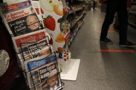Newspapers headline on President-elect Joe Biden Joe Biden's victory in the U.S presidential election, Sunday, Nov. 8, 2020 in a Paris supermarket. (AP Photo/Christophe Ena)