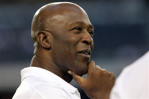 Chicago Bears head coach Lovie Smith watches his team before an NFL football game against the Dallas Cowboys, Monday, Oct. 1, 2012, in Arlington, Texas. (AP Photo/LM Otero)