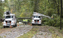 AT&T crews work on restoring service on Charlotte Drive after Tropical Storm Zeta swept through leaving thousands of households without power, Thursday, Oct. 29, 2020 in Alpharetta, Ga. (Hyosub Shin/Atlanta Journal-Constitution via AP)
