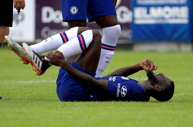 Tiemoue Bakayoko lies on his back on the pitch