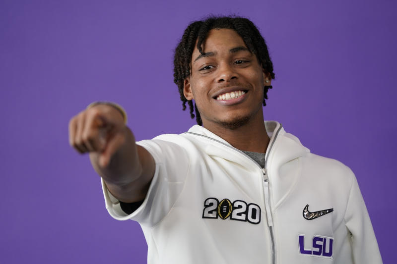 LSU wide receiver Justin Jefferson poses during media day for NCAA College Football Playoff national championship game Saturday, Jan. 11, 2020, in New Orleans. Clemson is scheduled to play LSU on Monday. (AP Photo/David J. Phillip).