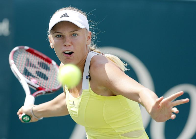 Caroline Wozniacki, of Denmark, returns to Silvia Soler-Espinosa, of Spain, during the Family Circle Cup tennis tournament in Charleston, S.C., on Wednesday, April 3, 2013. (AP Photo/Mic Smith)