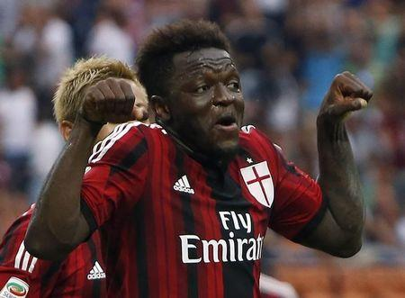 AC Milan's Muntari celebrates after scoring a goal against Lazio during their Italian Serie A soccer match in Milan