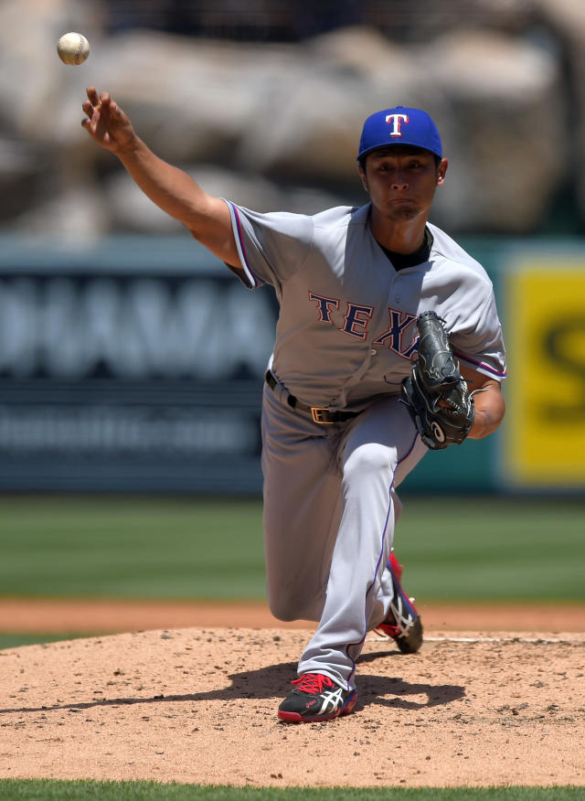 Texas Rangers starting pitcher Yu Darvish, of Japan, throws to the plate during the first inning of a baseball game against the Los Angeles Angels, Sunday, May 4, 2014, in Anaheim, Calif. (AP Photo/Mark J. Terrill)