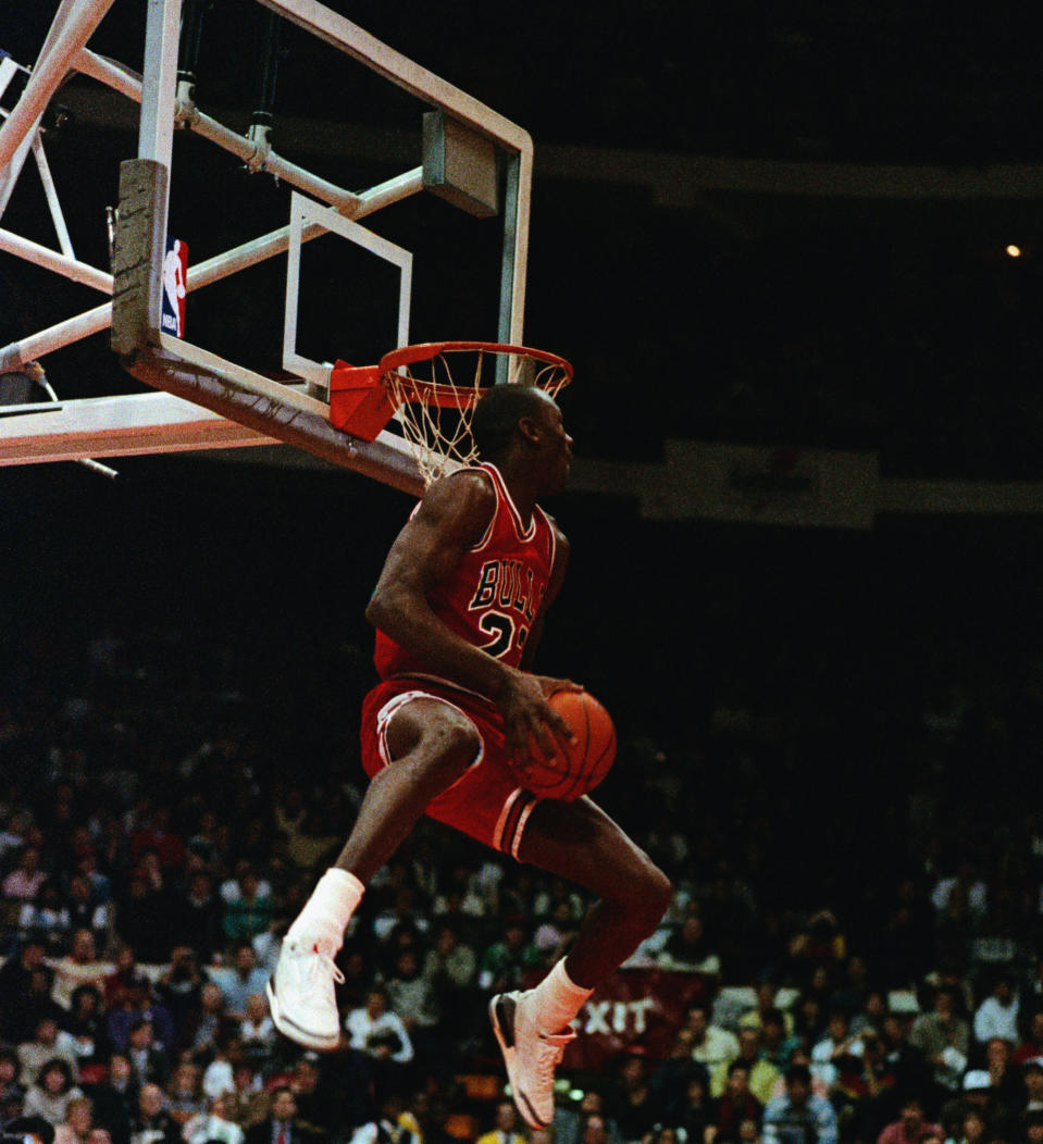 Michael Jordan wears the Air Jordan Cement III's during the 1988 Slam Dunk Contest. (Getty Images).
