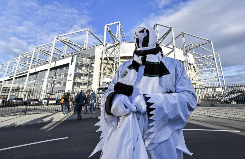 FILE - In this March 11, 2020, file photo, a Borussia fan dressed as a ghost stands in front of the stadium prior the German Bundesliga soccer match between Borussia Moenchengladbach and 1.FC Cologne in Moenchengladbach, Germany. These days, though, there is very little that is normal. The crippling coronavirus pandemic has brought the entire world including the sports world to a standstill, and it shows no sign of going away anytime soon. That has left fans wondering what life will be like when games finally resume. (AP Photo/Martin Meissner, File)