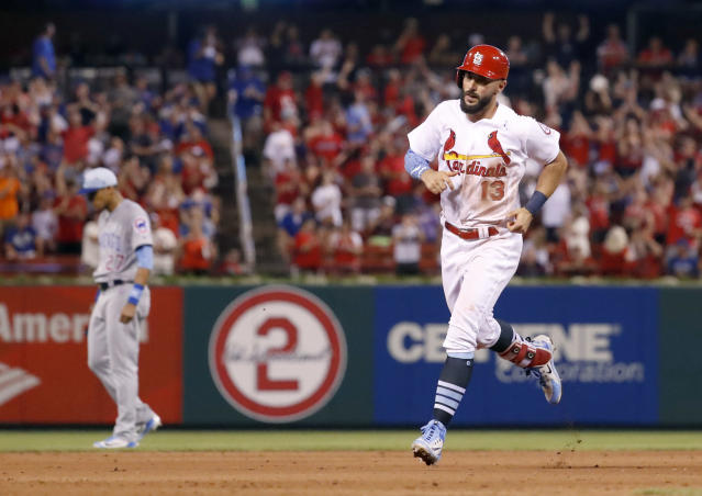 St. Louis Cardinals' Matt Carpenter, right, rounds the bases past Chicago Cubs shortstop Addison Russell, left, after hitting a solo home run during the seventh inning of a baseball game, Sunday, June 17, 2018, in St. Louis. (AP Photo/Jeff Roberson)