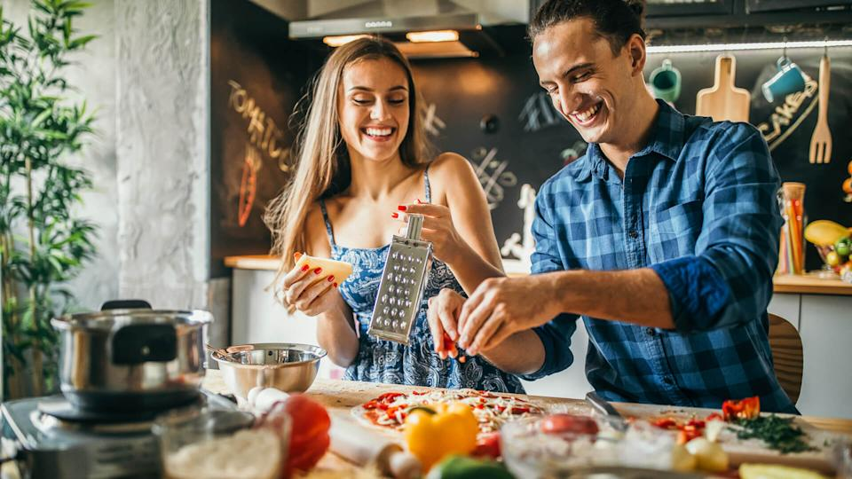 millennials cooking dinner athome to save money to become millionaires