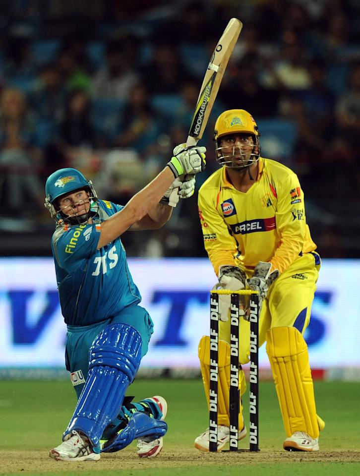 Pune Warriors India batsman Steven Smith (L) watched by Chennai Super Kings cricketer Mahendra Singh Dhoni plays a shot during the IPL Twenty20 cricket match between Pune Warriors India and Chennai Super Kings at The Subrata Roy Sahara Stadium in Pune on April 14, 2012.   AFP PHOTO/Indranil MUKHERJEE RESTRICTED TO EDITORIAL USE. MOBILE USE WITHIN NEWS PACKAGE (Photo credit should read INDRANIL MUKHERJEE/AFP/Getty Images)