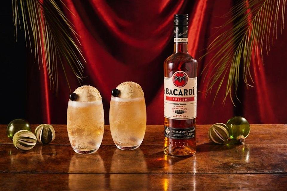 """<p>Add 50ml<a href=""""https://www.tesco.com/groceries/en-GB/products/303215339"""" rel=""""nofollow noopener"""" target=""""_blank"""" data-ylk=""""slk:Bacardi Spiced"""" class=""""link rapid-noclick-resp""""> Bacardi Spiced</a> and one scoop of vanilla ice cream to a highball glass. Top with lemonade and garnish with nutmeg and a cherry.<br></p>"""