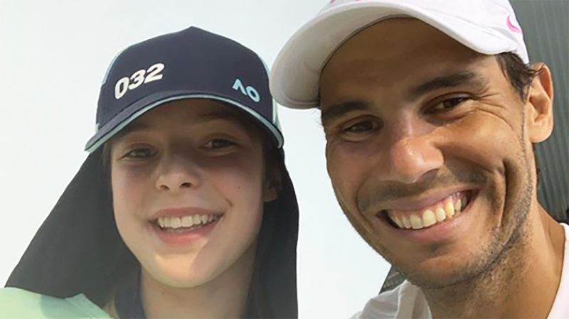Rafael Nadal is pictured posing for a picture with ball girl Anita Birchall.