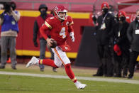 Kansas City Chiefs quarterback Chad Henne scrambles up field during the second half of an NFL divisional round football game against the Cleveland Browns, Sunday, Jan. 17, 2021, in Kansas City. (AP Photo/Charlie Riedel)