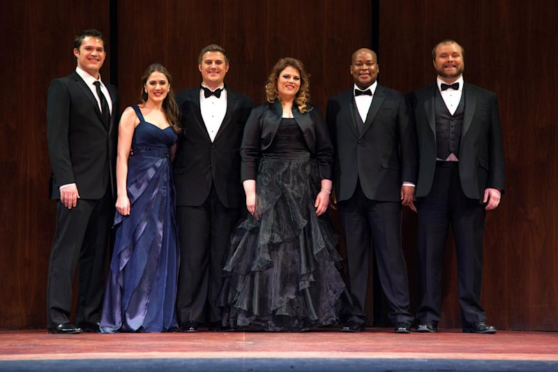 This March 10, 2013 photo provided by the Metropolitan Opera shows the winners of the Metropolitan Opera National Council Grand Finals Concert in New York. The winners, from left, Brandon Cedel, Sydney Mancasola, Michael Brandenburg, Rebecca Pedersen, Musa Ngqungwana and Thomas Richards, will each receive a $15,000 grant for further study. (AP Photo/Metropolitan Opera, Rebecca Fay)