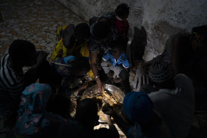 Ndeye Yacine Dieng breaks the fast with her family during the holy month of Ramadan at her home in Bargny, Senegal some 35 kilometers (22 miles) east of Dakar, Senegal, Wednesday April 21, 2021. (AP Photo/Leo Correa)