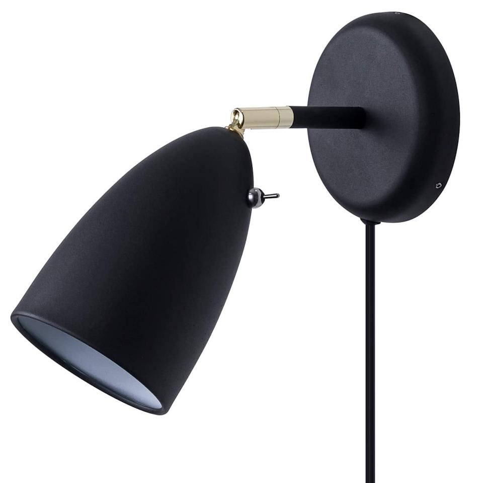 "<p>This <a href=""https://www.popsugar.com/buy/Chiyan-Lighting-Wall-Sconce-508954?p_name=Chiyan%20Lighting%20Wall%20Sconce&retailer=amazon.com&pid=508954&price=30&evar1=casa%3Aus&evar9=46825312&evar98=https%3A%2F%2Fwww.popsugar.com%2Fphoto-gallery%2F46825312%2Fimage%2F46828512%2FMore-Sconces-Under-100&prop13=api&pdata=1"" rel=""nofollow"" data-shoppable-link=""1"" target=""_blank"" class=""ga-track"" data-ga-category=""Related"" data-ga-label=""https://www.amazon.com/Rotatable-Industrial-Simplicity-Hardwired-Lighting/dp/B07JJMX4V4/ref=sr_1_57_sspa?keywords=midcentury+black+sconce+plug+in&amp;qid=1572456671&amp;sr=8-57-spons&amp;psc=1&amp;spLa=ZW5jcnlwdGVkUXVhbGlmaWVyPUExNkVNSzZFWENZSFNSJmVuY3J5cHRlZElkPUEwMjIyMjA2TUs1VEZKUVY4R1dLJmVuY3J5cHRlZEFkSWQ9QTA0NDI4MDMxN09TUjgzVU0xNUtEJndpZGdldE5hbWU9c3BfYnRmJmFjdGlvbj1jbGlja1JlZGlyZWN0JmRvTm90TG9nQ2xpY2s9dHJ1ZQ=="" data-ga-action=""In-Line Links"">Chiyan Lighting Wall Sconce</a> ($30) doesn't extend very far from the wall, but it has the same matte black and brass tones and is a steal at $30!</p>"