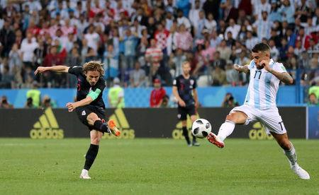 Croatia's Luka Modric scores their second goal. REUTERS/Ivan Alvarado