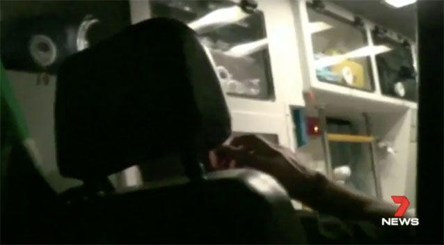 Pillar is seen in police video on the phone after the crash. Source: 7 News