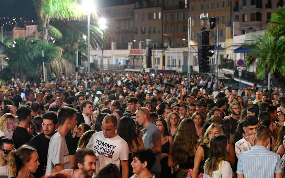 Crowds gather for the concert in Nice - YANN COATSALIOU/AFP via Getty Images