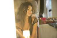 A stylist gives the Angel perfectly appropriate tousled beach waves — and Aldridge seems to love it. The girls had a 5 AM call time each morning for hair and makeup before heading straight to the beach.