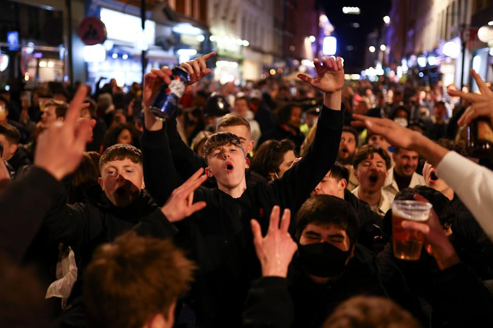 <p>People singing and dancing in the street in central London </p> (REUTERS)