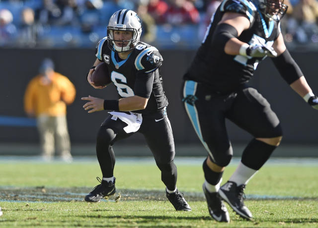 Carolina Panthers' Taylor Heinicke (6) runs against the Atlanta Falcons during the first half of an NFL football game in Charlotte, N.C., Sunday, Dec. 23, 2018. (AP Photo/Mike McCarn)