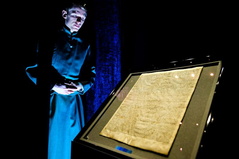 Salisbury Cathedral Verger Tyler Ringwood-Hoare, inspects the reinstalled original Magna Carta inside the medieval Chapter House, where it was attacked and had to be removed.