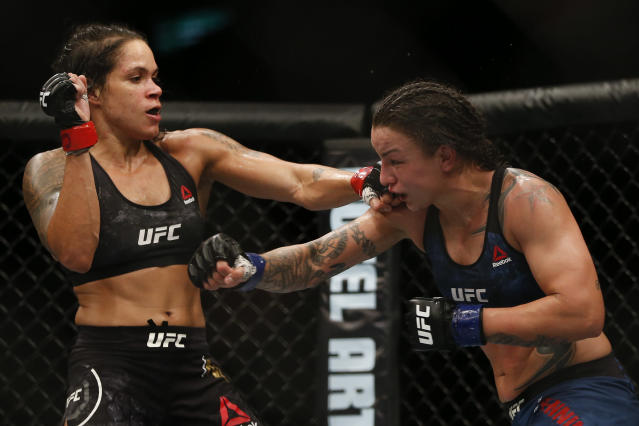 Amanda Nunes, left, fights Raquel Pennington during their UFC women's bantamweight mixed martial arts bout in Rio de Janeiro, Brazil, on May 13, 2018. (AP Photo/Leo Correa)