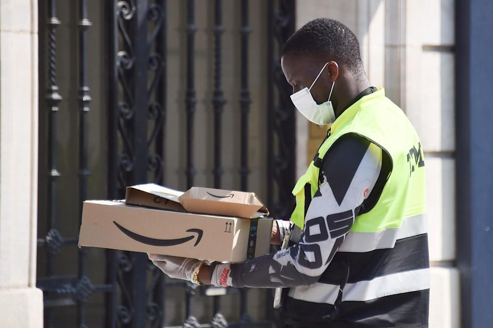 PARIS, FRANCE - APRIL 10: An Amazon delivery driver delivers packages on April 10, 2020 in Paris, France. The country is issuing fines for people caught violating its nationwide lockdown measures intended to stop the spread of COVID-19. The Coronavirus (COVID-19) pandemic has spread to many countries across the world, claiming over 90,000 lives and infecting over 1 million people.