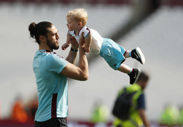 West Ham United's Andy Carroll with his son