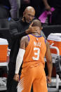 Phoenix Suns head coach Monty Williams, left, embraces Chris Paul as time runs out in Game 6 of the NBA basketball Western Conference Finals against the Los Angeles Clippers Wednesday, June 30, 2021, in Los Angeles. The Suns won the game 130-103 to take the series 4-2. (AP Photo/Mark J. Terrill)
