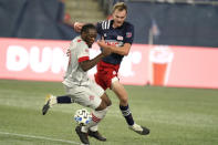 Toronto FC's Ayo Akinola, left, and New England Revolution's Henry Kessler vie for control of the ball during the second half of an MLS soccer match Wednesday, Oct. 7, 2020, in Foxborough, Mass. (AP Photo/Steven Senne)