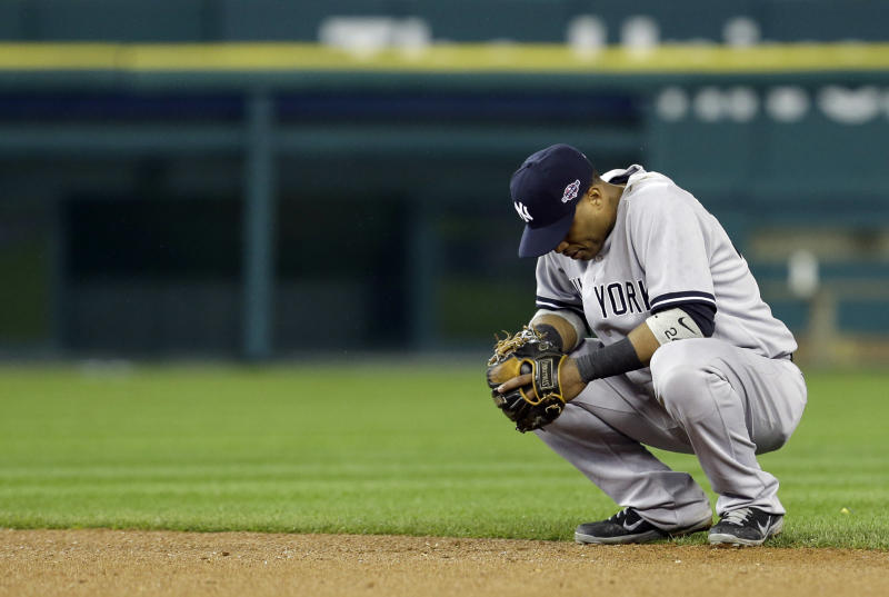 New York Yankees' Robinson Cano waits in the eighth inning during Game 3 of the American League championship series against the Detroit Tigers Tuesday, Oct. 16, 2012, in Detroit. (AP Photo/Paul Sancya )