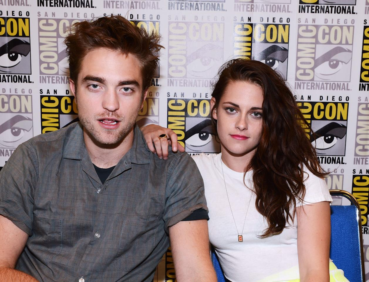 "SAN DIEGO, CA - JULY 12: Actors Robert Pattinson (L) and Kristen Stewart attend ""The Twilight Saga: Breaking Dawn Part 2"" during Comic-Con International 2012 at San Diego Convention Center on July 12, 2012 in San Diego, California.  (Photo by Michael Buckner/Getty Images for Lionsgate)"