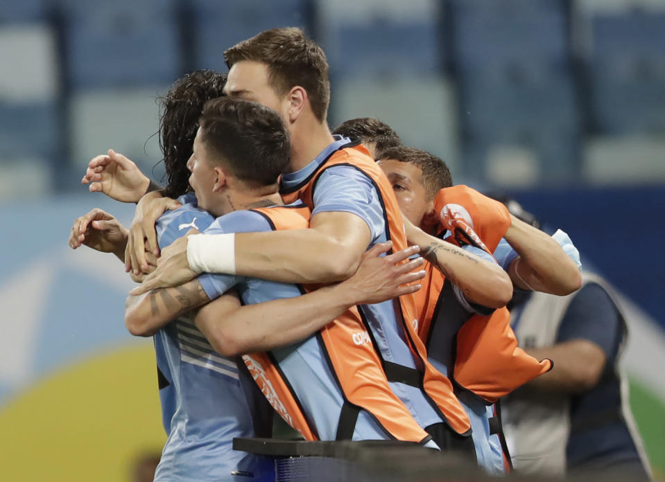 Uruguay's Edinson Cavani celebrates with his teammates after scoring his team's second goal against Bolivia during a Copa America soccer match at Arena Pantanal in Cuiaba, Brazil, Thursday, June 24, 2021. (AP Photo/Andre Penner)