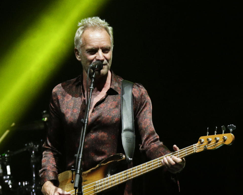 FILE - In this Oct. 19, 2018, file photo, singer Sting performs during a concert with singer Shaggy, not in frame, as part of their 'The 44/876' tour in Panama City. Sting, Christina Aguilera and revelers from around the world are set to welcome 2019 in New York City's Times Square. (AP Photo/Arnulfo Franco)