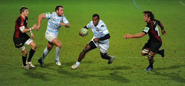 Racing's wing Sereli Bobo (2nd R) avoids a tackle from Saracen's flanker Jacques Burger (R) on his way to scoring a try during the Heineken Cup rugby union match between Saracens and Racing Metro 92 at Vicarage Road in Watford on December 11, 2010. Racing Metro 92 won the game 24-21. AFP PHOTO / Adrian Dennis (Photo credit should read ADRIAN DENNIS/AFP/Getty Images)