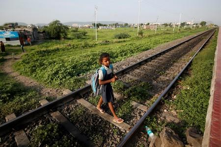 The Wider Image: The Indian children who take a train to collect water