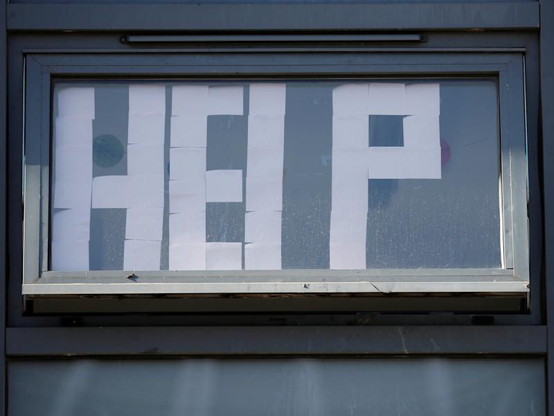 A 'Help' message is displayed at locked down student accommodation in Manchester (REUTERS)