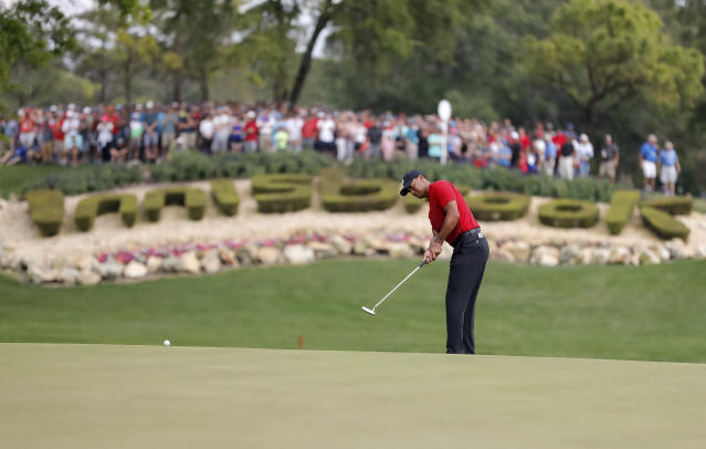 Tiger Woods putts on the 14th hole during the final round of the Valspar Championship golf tournament Sunday, March 11, 2018, in Palm Harbor, Fla. (AP Photo/Mike Carlson)