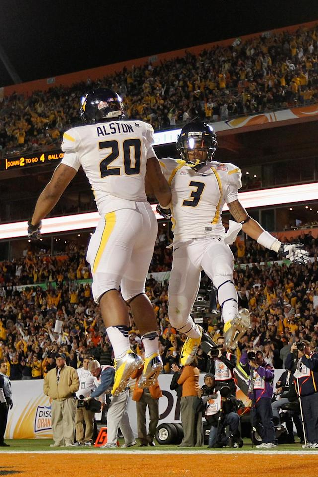 MIAMI GARDENS, FL - JANUARY 04: Shawne Alston #20 and Stedman Bailey #3 of the West Virginia Mountaineers celebrate after Alston rushds for a 4-yard touchdown in the first quarter against the Clemson Tigers during the Discover Orange Bowl at Sun Life Stadium on January 4, 2012 in Miami Gardens, Florida. (Photo by J. Meric/Getty Images)