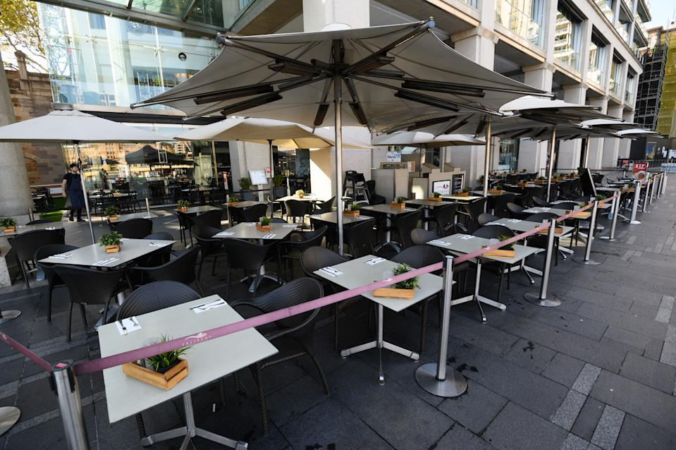 Empty tables at a restaurant in Circular Quay, Sydney. Source: AAP
