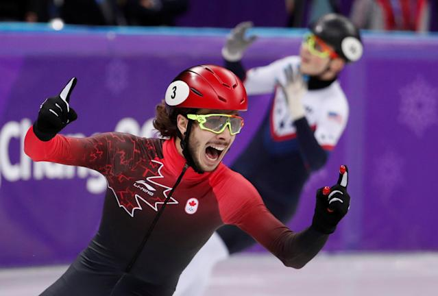 Short Track Speed Skating Events - Pyeongchang 2018 Winter Olympics - Men's 1000m Final - Gangneung Ice Arena - Gangneung, South Korea - February 17, 2018 - Gold medallist Samuel Girard of Canada celebrates in front of silver medallist John-Henry Krueger of the U.S.. REUTERS/Damir Sagolj TPX IMAGES OF THE DAY