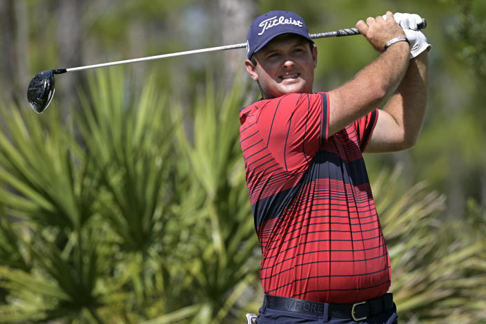 FILE - In this Feb. 27, 2021, file photo, Patrick Reed watches his tee shot on the second hole during the third round of the Workday Championship golf tournament in Bradenton, Fla. (AP Photo/Phelan M. Ebenhack, File)