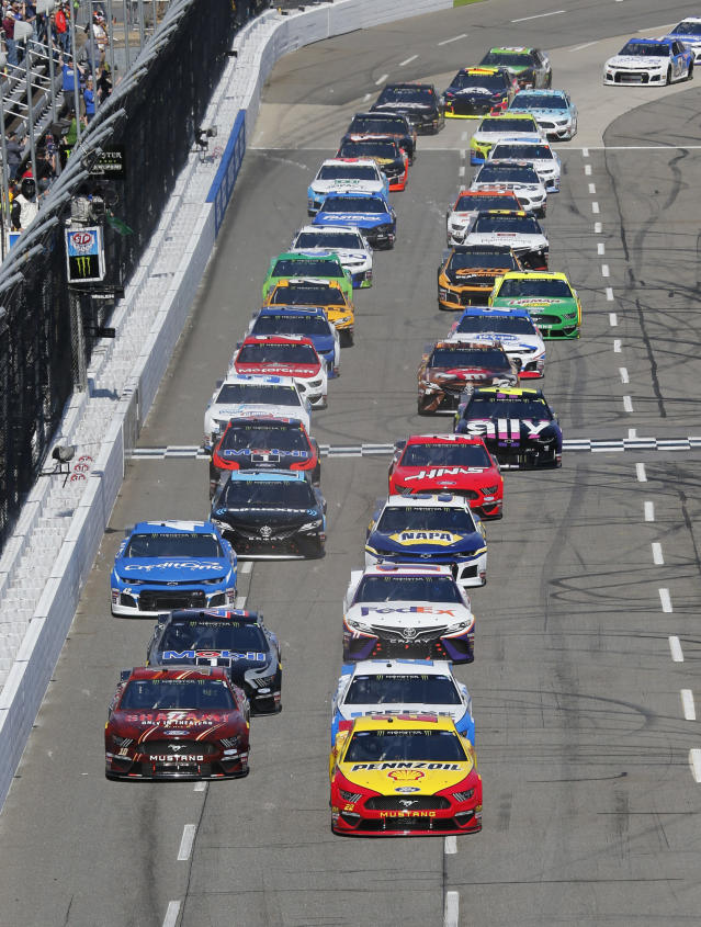 Joey Logano (22) leads the field at the start of a NASCAR Cup Series auto race at the Martinsville Speedway in Martinsville, Va., Sunday, March 24, 2019. (AP Photo/Steve Helber)