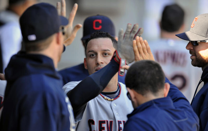 Cleveland Indians' Asdrubal Cabrera celebrates with teammates in the dugout after scoring on a Drew Stubbs single during the fourth inning of a baseball game against the Chicago White Sox in Chicago, Friday, Sept. 13, 2013. (AP Photo/Paul Beaty)