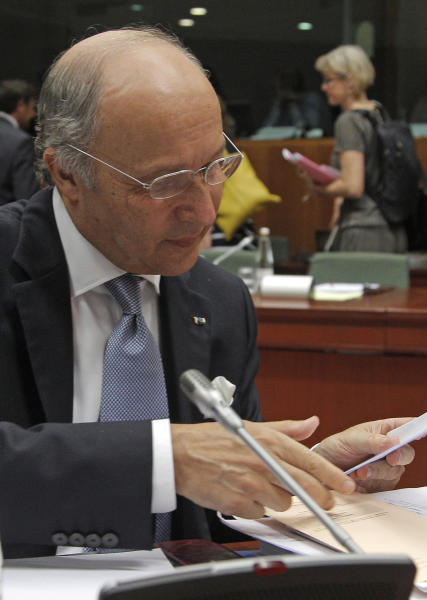 French Foreign Minister Laurent Fabius looks into his papers during the EU foreign ministers meeting at the European Council building in Brussels, Monday, July 22, 2013. European Union foreign ministers were set Monday to tackle the thorny question of whether Hezbollah's military wing should be blacklisted as a terrorist organization, at a meeting in Brussels that is also due to feature talks on Egypt and Syria. (AP Photo/Yves Logghe)