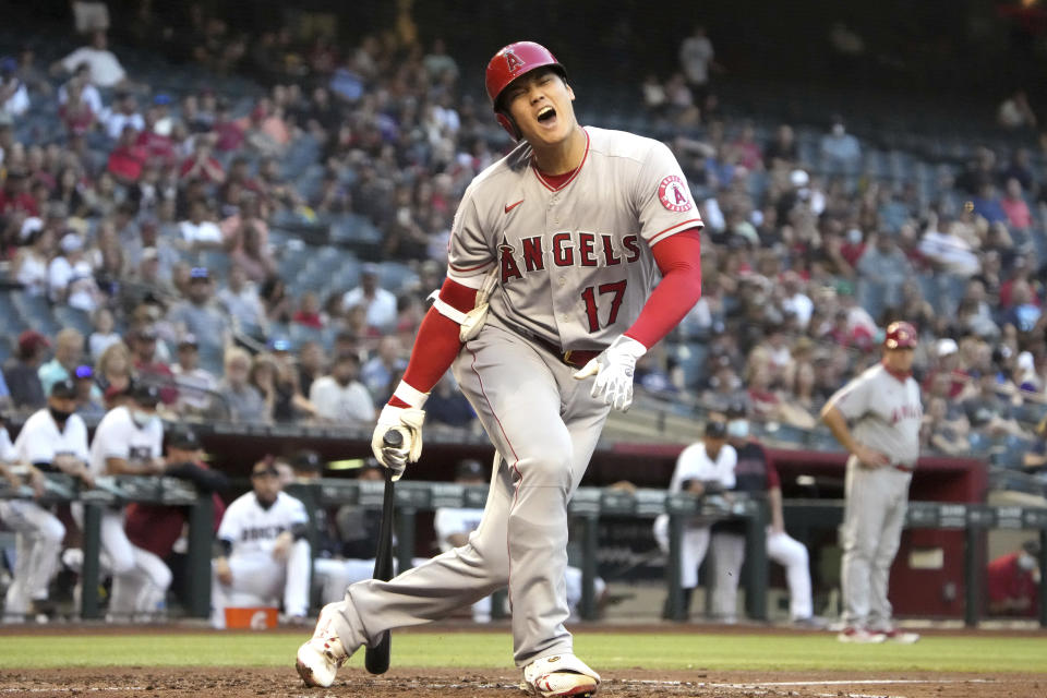 Los Angeles Angels' Shohei Ohtani reacts after fouling a pitch off his foot in the third inning during a baseball game against the Arizona Diamondbacks, Friday, June 11, 2021, in Phoenix. (AP Photo/Rick Scuteri)