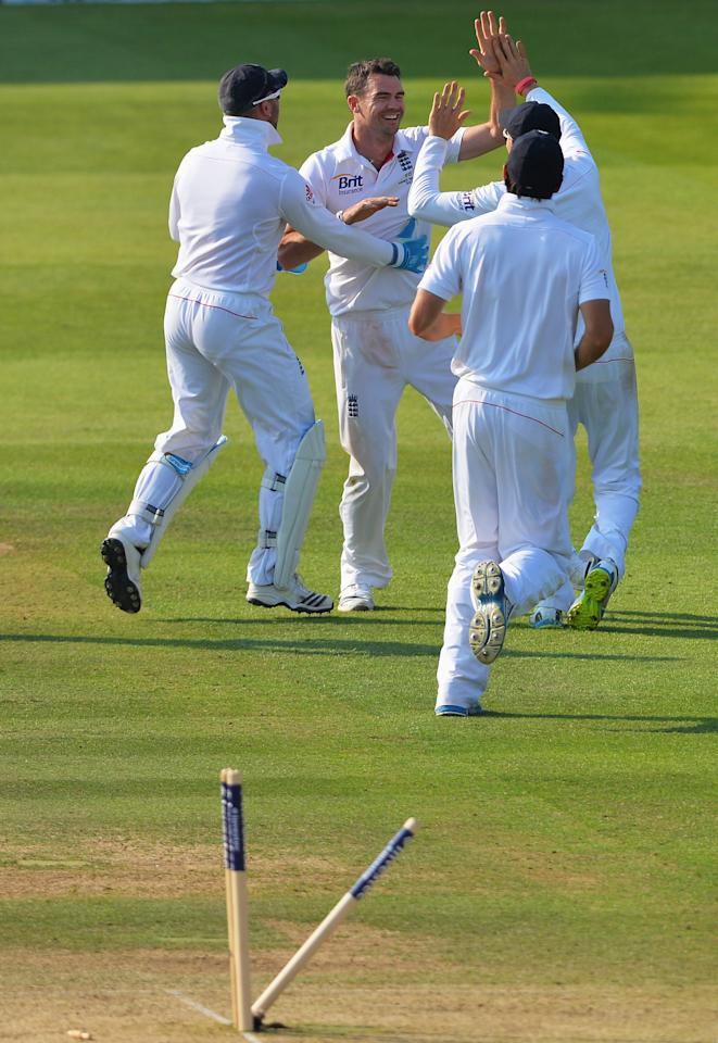 LONDON, ENGLAND - JULY 21: James Anderson of England celebrates the wicket of Peter Siddle of Australia with team mates during day four of the 2nd Investec Ashes Test match between England and Australia at Lord's Cricket Ground on July 21, 2013 in London, England. (Photo by Mike Hewitt/Getty Images)